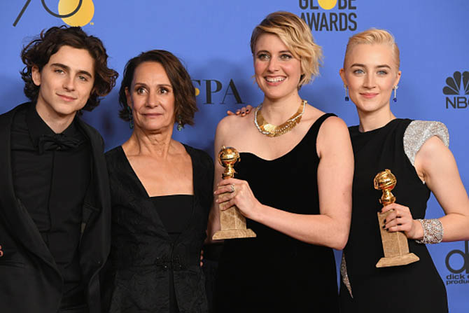 Director Greta Gerwig poses with members of the cast of her film 'Lady Bird,' Timothee Chalamet, Laurie Metcalf and Saoirse Ronan after winning the for Best Motion Picture Musical or Comedy at the 75th Annual Golden Globe Awards Photo by Kevin Winter/Getty Images