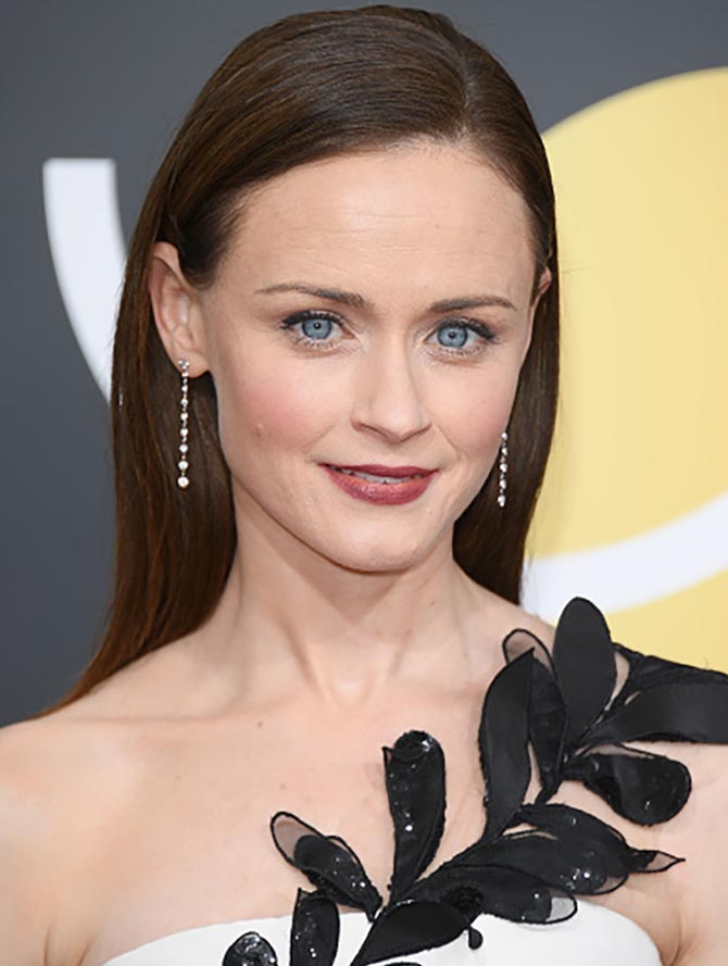 Actor Alexis Bledel in Forevermark earrings at The 75th Annual Golden Globe Awards