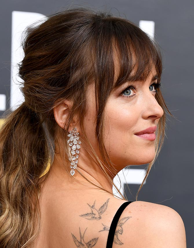Detail shot of Dakota Johnson in the Nirav Modi Luminance Cascade Earrings featuring a variety of diamond shapes at the Golden Globes. Photo Getty