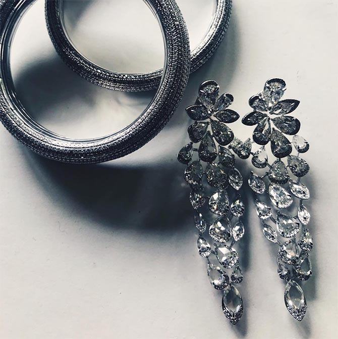 Stylist Kate Young's Instagram of Dakota Johnnson's Golden Globes Nirav Modi diamond and 18K white gold bracelets and earrings. Photo @kateyoung/Instagram