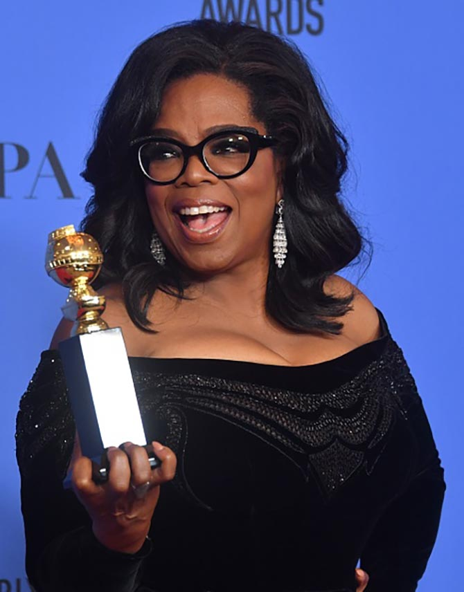 Oprah Winfrey poses with the Cecil B. DeMille Award during the 75th Golden Globe Awards on January 7, 2018, in Beverly Hills, California. / AFP PHOTO / Frederic J. BROWN (Photo credit should read FREDERIC J. BROWN/AFP/Getty Images)