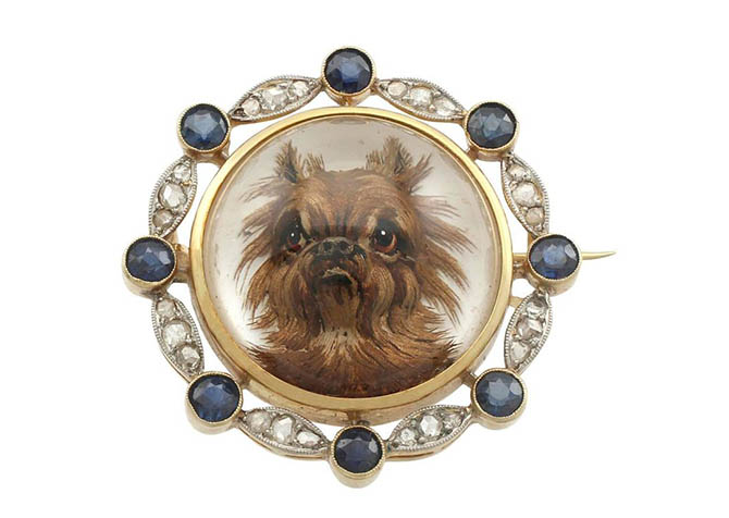 Antique brooch with a crystal portrait of a Brussels Griffon set in a gold, diamond and sapphire brooch