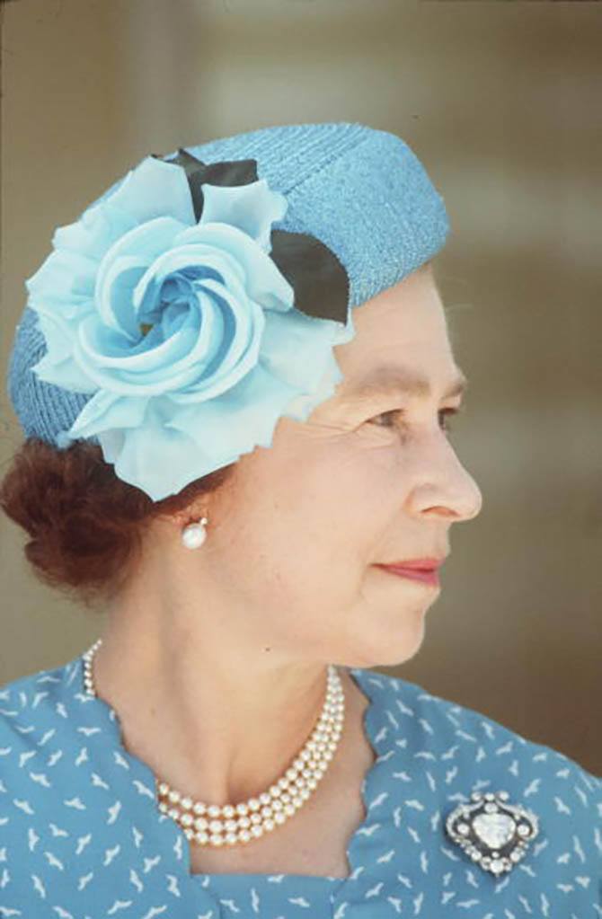 Queen Elizabeth in 1982 wearing seemingly the same set of jewels she wore to London Fashion Week, pearl and diamond button earrings, a triple strand of pearls and the Cullinan V brooch. Photo Getty