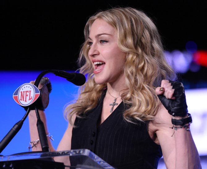 For her press conference for the 2012 Super Bowl Madonna sported was covered in crucifixes including a Cartier bracelet. Photo Getty