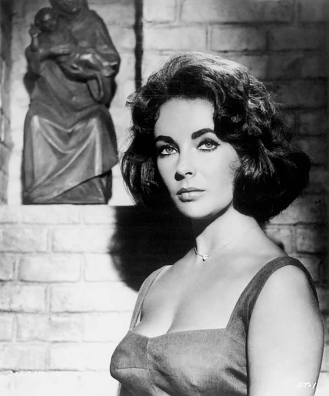 Elizabeth Taylor wearing her diamond heart pendant on the set of 'Suddenly Last Summer.' Photo Corbis/Getty