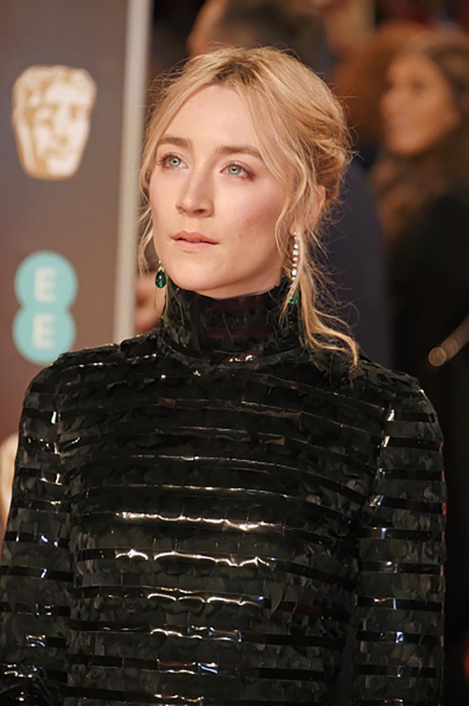 Saoirse Ronan in Cartier emerald, diamond and platinum earrings.