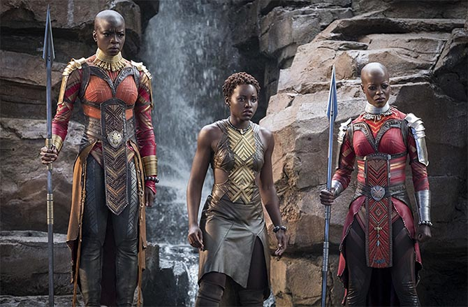 A scene from 'Black Panther' at Warrior Falls with Nakia (Lupita Nyong'o) and the Dora Milaje, Okoye (Danai Gurira) and Ayo (Florence Kasumba), showing their jewelry and body armor. Photo Marvel Studios