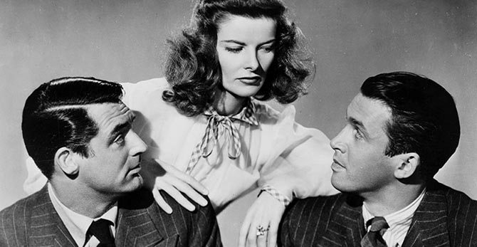 In a publicity still for 'Philadelphia Story,' Cary Grant and Jimmy Stewart pose with Katharine Hepburn who is wearing a Verdura engagement Ring.