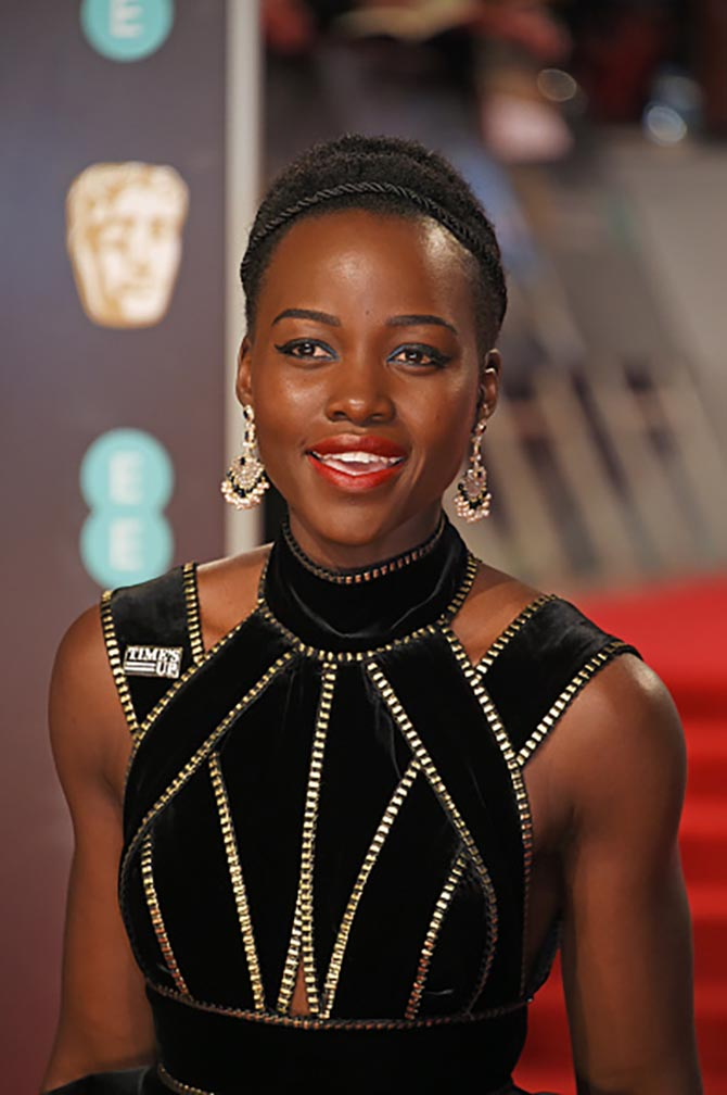 Lupita Nyong'o in sapphire, pearl and diamond fan-shaped earrings by Sanjay Kasilwal of the Gem Palace.
