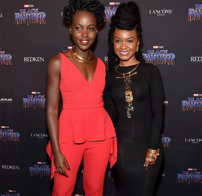 Lupita Nyong'o wearing necklaces by the 'Black Panther' jewelry designers Douriean Fletcher who she is posing at the MARVEL Black Panther fashion week celebration 'Welcome to Wakanda' Photo Getty