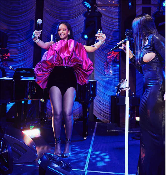 Rihanna on stage with Toni Braxton at her 30th birthday party wearing one million dollars in jewels.