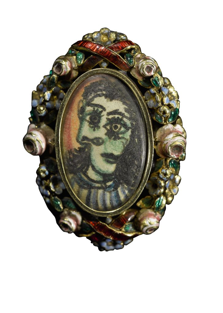 The Dora Maar portrait ring created by Picasso in the late 1930s is composed of a costume ring he found and a painting of Maar in the Cubist style he slipped into the center compartment. Photo Sotheby's