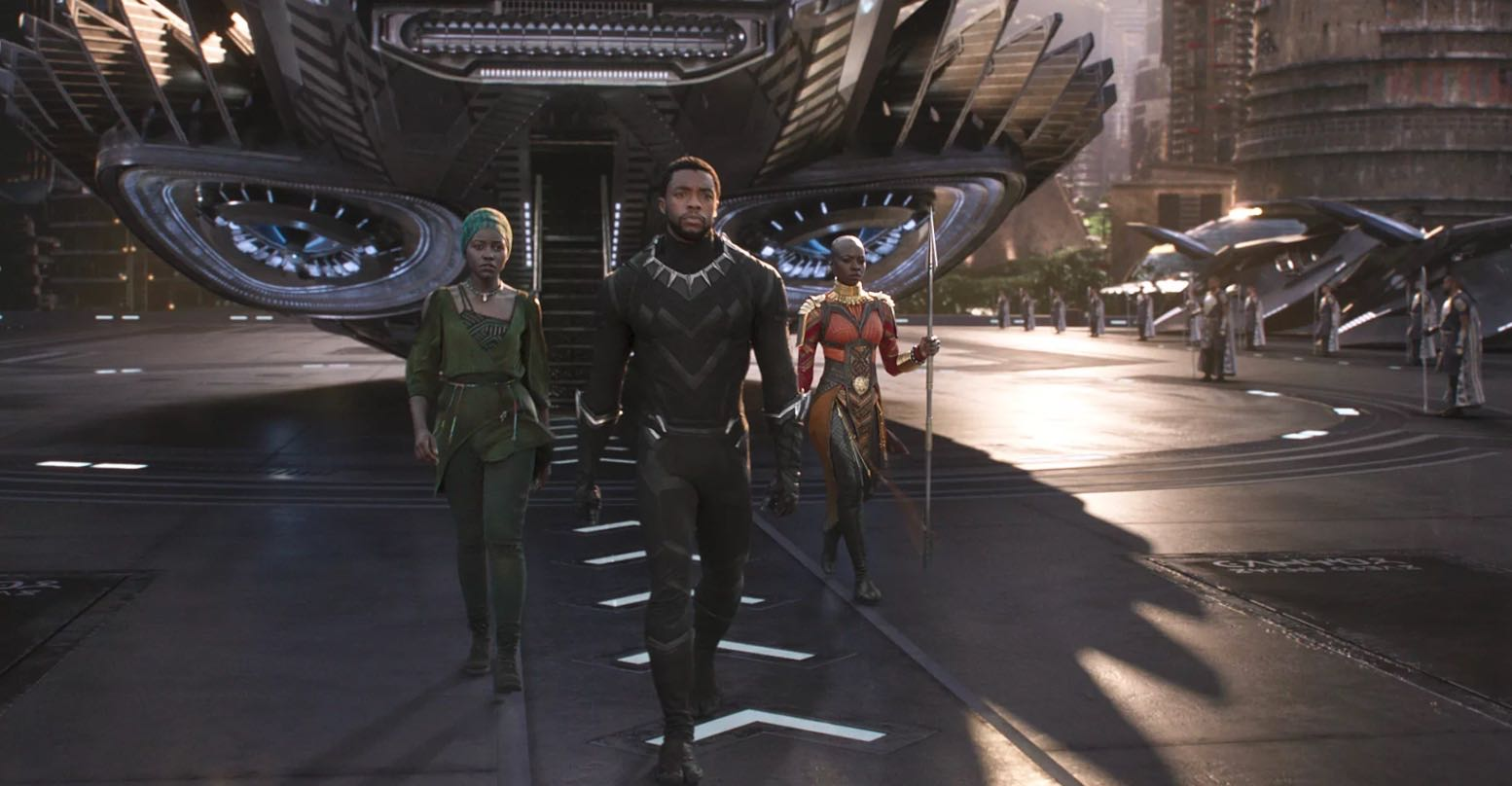 In a scene from 'The Black Panther,' Nakia (Lupita Nyong'o) in her bead necklace, the Black Panther, (Chadwick Boseman) in his claw necklace and Ayo (Florence Kasumba) in her jewelry and body armor. Photo Marvel Studios