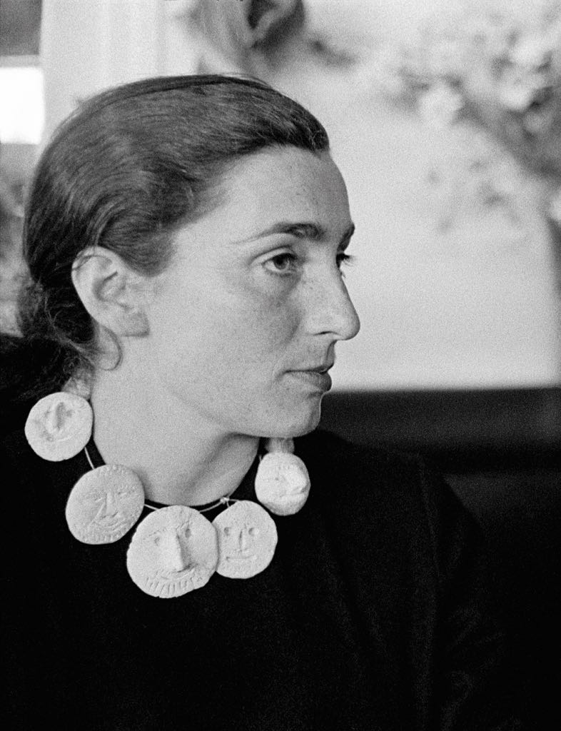 Picasso's wife Jacqueline Roque wearing a ceramic necklace her created for he. From 'Art as Jewellery: From Calder to Kapoor' Courtesy of Harry Ransom Center at the University of Texas at Austin, Photograph by David Douglas Duncan, 1957, © Succession Picasso/DACS, London 2017