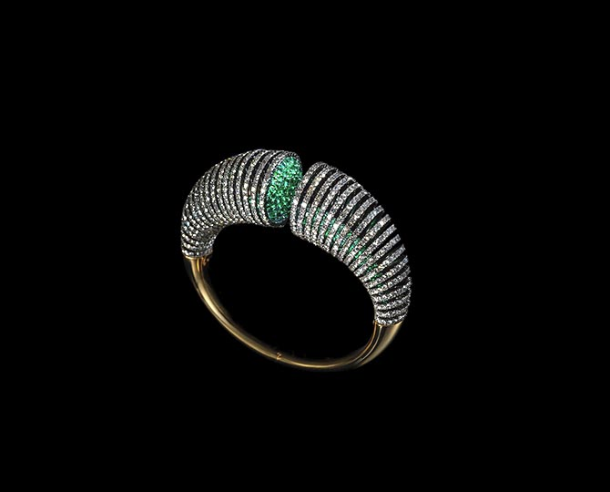 Diamonds, emeralds, silver and gold Slinky Cuff by Lauren Adriana