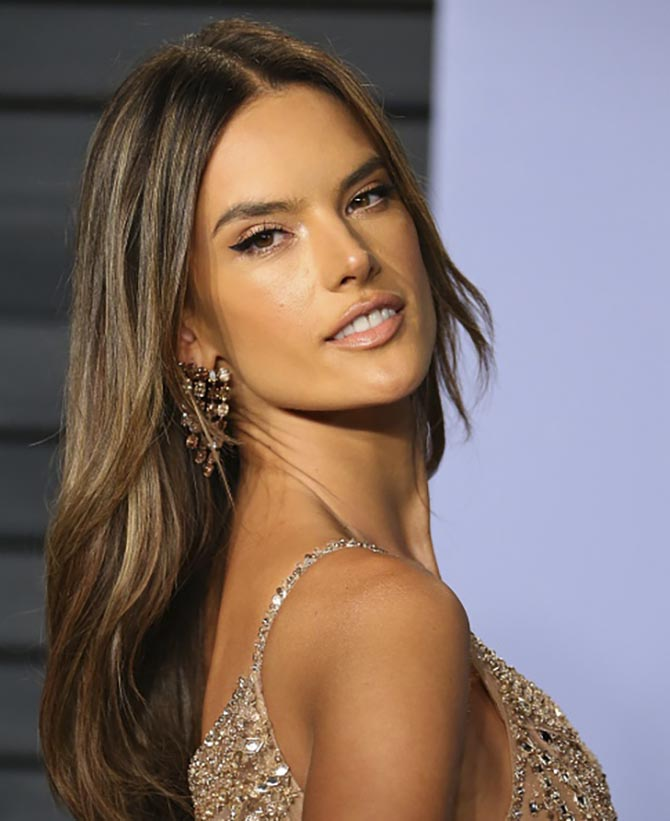 Alessandra Ambrosio 18 karat rose gold and nude diamond climbing drop earrings by Lorraine Schwartz