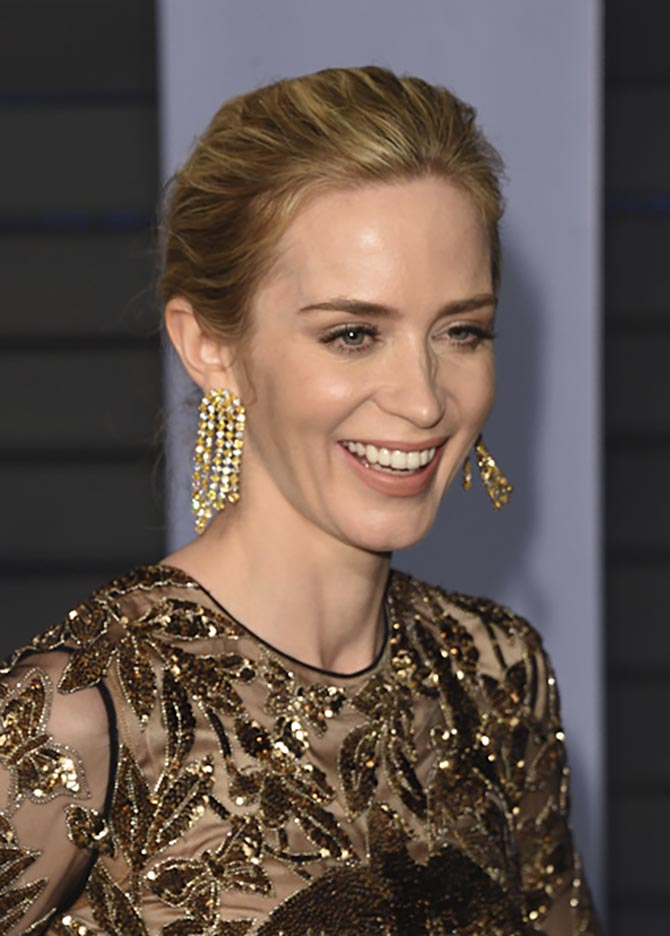 Emily Blunt in diamond earrings by Chopard.