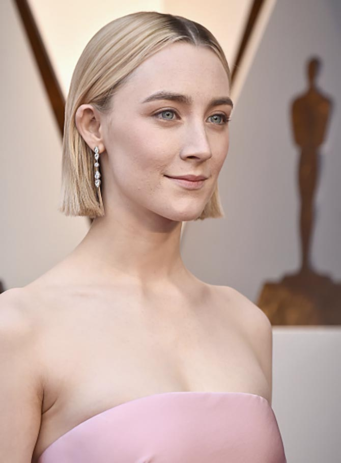 Saoirse Ronan in diamond and platinum earrings from Cartier.