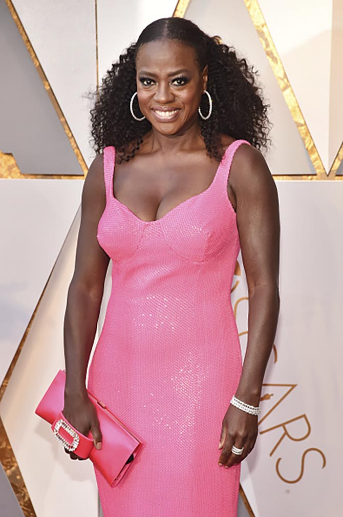 Viola Davis in diamond hoops, bracelets and rings from Norman Silverman.