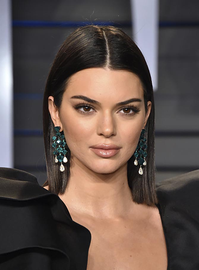 Kendall Jenner in emerald and diamond earrings by Lorraine Schwartz