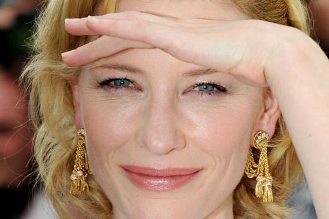 "CANNES, FRANCE - MAY 12: Actress Cate Blanchett in Van Cleef & Arpels vintage earrings at the the ""Robin Hood"" Photocall at the Palais des Festivals during the 63rd Annual Cannes Film Festival on May 12, 2010 in Cannes, France. (Photo by Pascal Le Segretain/Getty Images)"