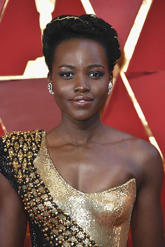 Lupita Nyong'o in diamond earrings by Niwaka.