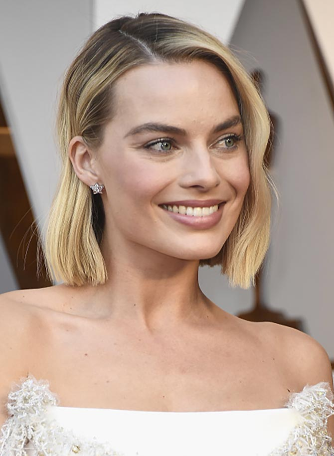 Margot Robbie in diamond star earrings by Chanel