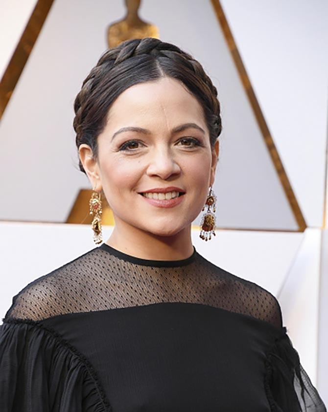 Natalia Lafourcade, who performed in 'Coco,' wearing pendant earrings.