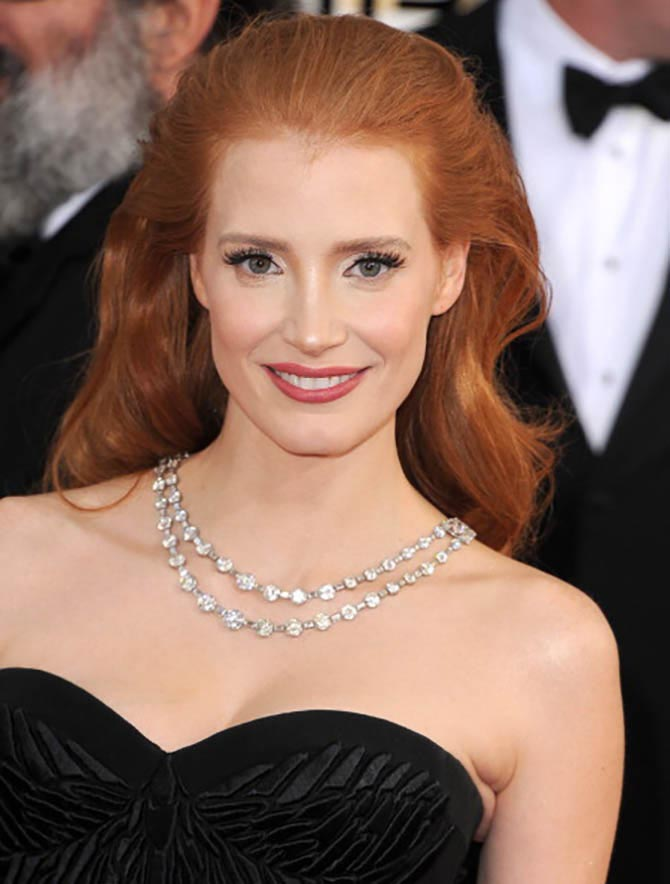 Jessica Chastain arrives at the 71st Annual Golden Globe Awards on January 12, 2014 in the Bulgari Art Deco necklace. Photo by Steve Granitz/WireImage