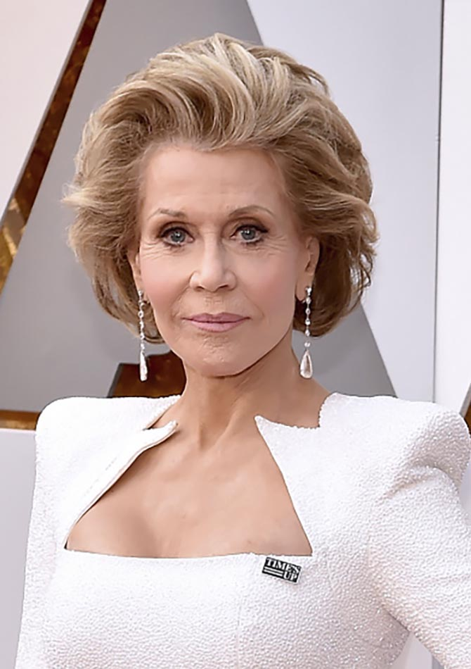 Jane Fonda in 25-carat diamond earrings by Chopard