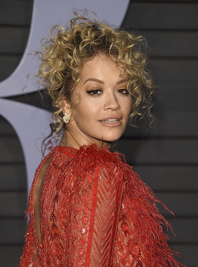 Rita Ora in diamond and gold Knot earrings by Lorraine Schwartz.