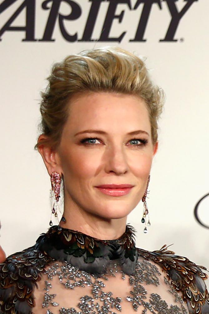 CANNES, FRANCE - MAY 15: Cate Blanchett in shrimp Choard earrings attends the Chopard Trophy during the 67th Annual Cannes Film Festival on May 15, 2014 in Cannes, France. (Photo by Andreas Rentz/Getty Images)