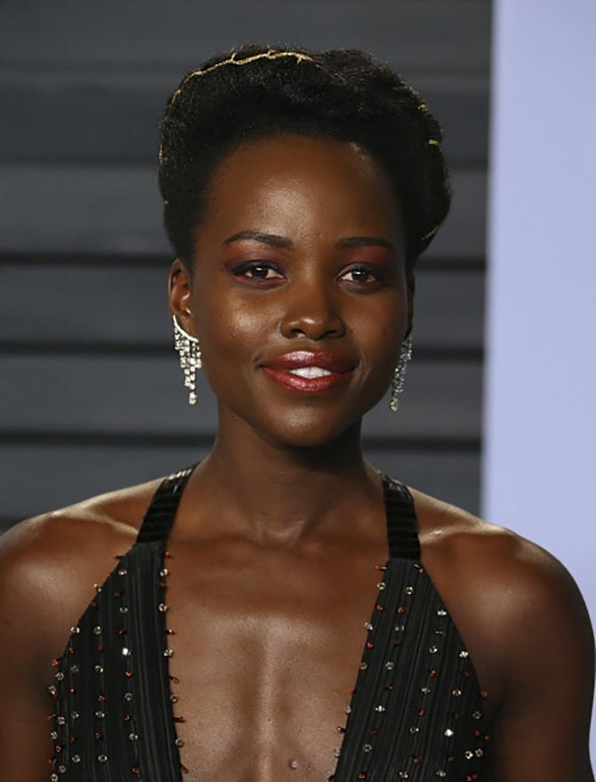 Lupita Nyong'o in diamond earrings by Forevermark.