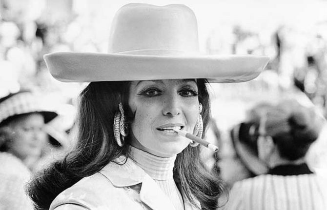 Maria Felix wearing her Cartier Snake earrings at a horse race in Paris in 1972. Photo via The Red List
