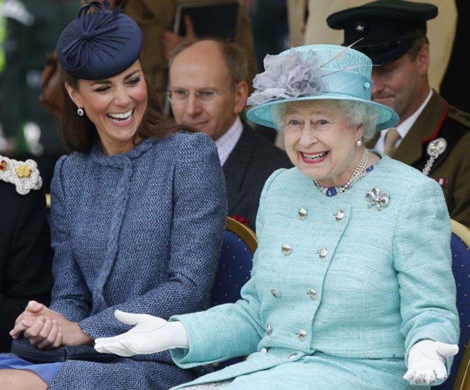 Catherine, Duchess of Cambridge and Queen Elizabeth II who is wearing Queen Mary's Button Earrings on June 13, 2012 in Nottingham, England. Photo by Phil Noble - WPA Pool/Getty Images
