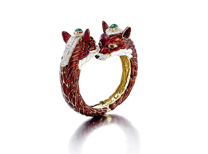 David Webb diamond, emerald, ruby and enamel double fox head bangle bracelet featured in Bonhams April 17 Fine Jewelry sale. Photo courtesy