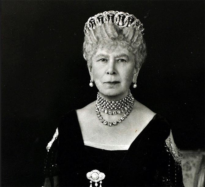 Queen Mary wearing her Button Earrings around 1930 along with several other jewels. Photo Getty