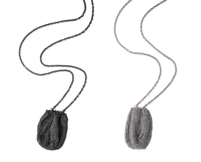 Voler necklace for crystals shown in black rhodium plated silver and silver. Photo courtesy