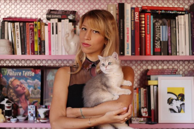 Jewelry designer Bea Bongiasca poses with her cat in Milan. Photo courtesy