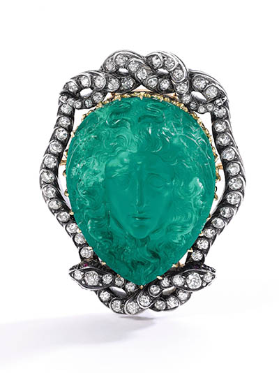 The fine emerald cameo depicting Medusa shown out of the bracelet in the brooch setting with diamond snakes. Photo Sotheby's