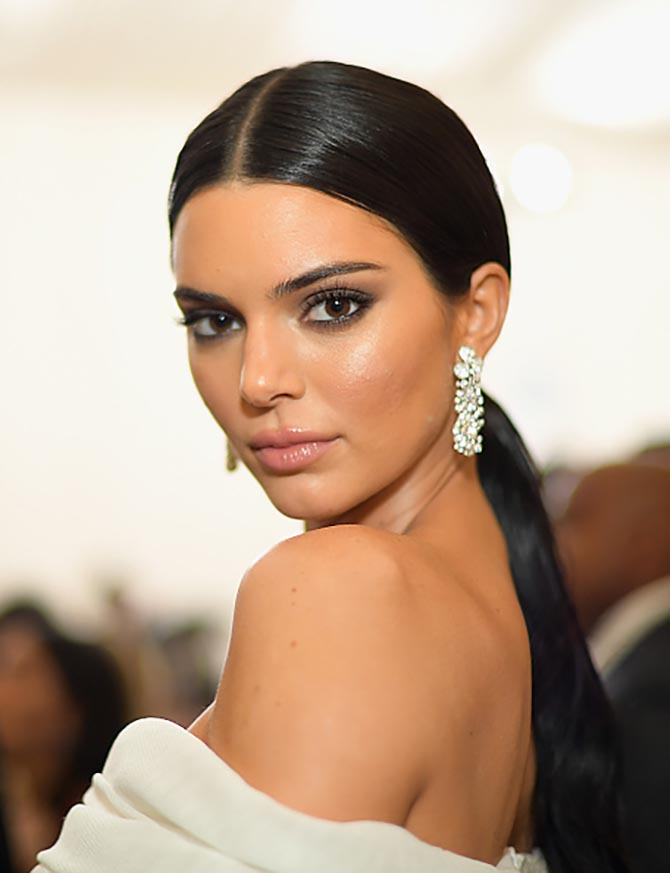 Kendall Jenner sparkled in diamond earrings from Tiffany's new Paper Flowers collection and a pantsuit from Off-White.