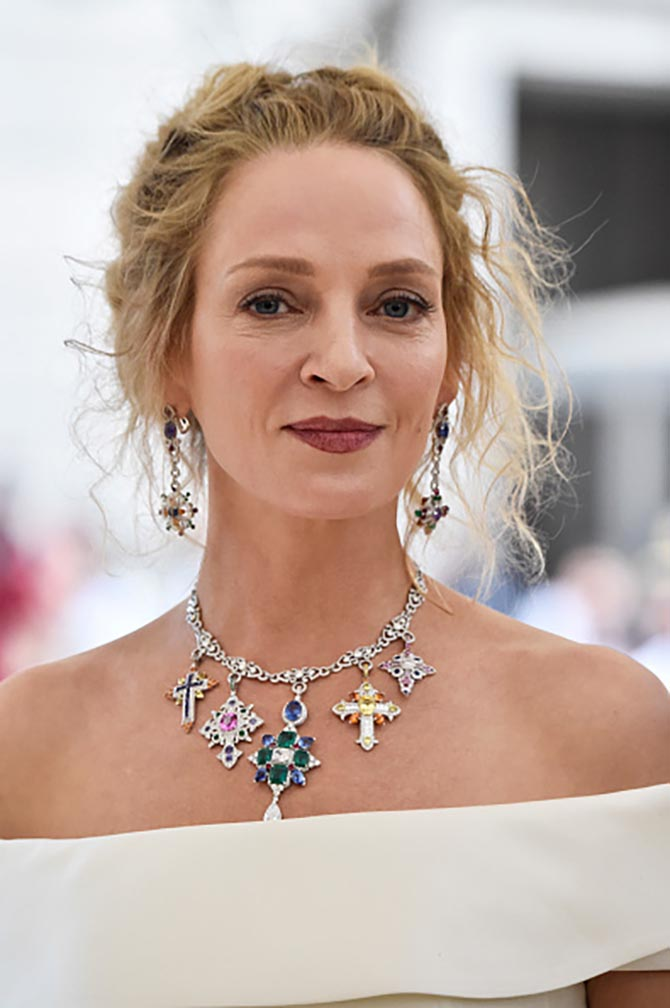 Uma Thurman paired a colorful Giampiero Bodino necklaces of crosses with a Gabriela Hearst dress.