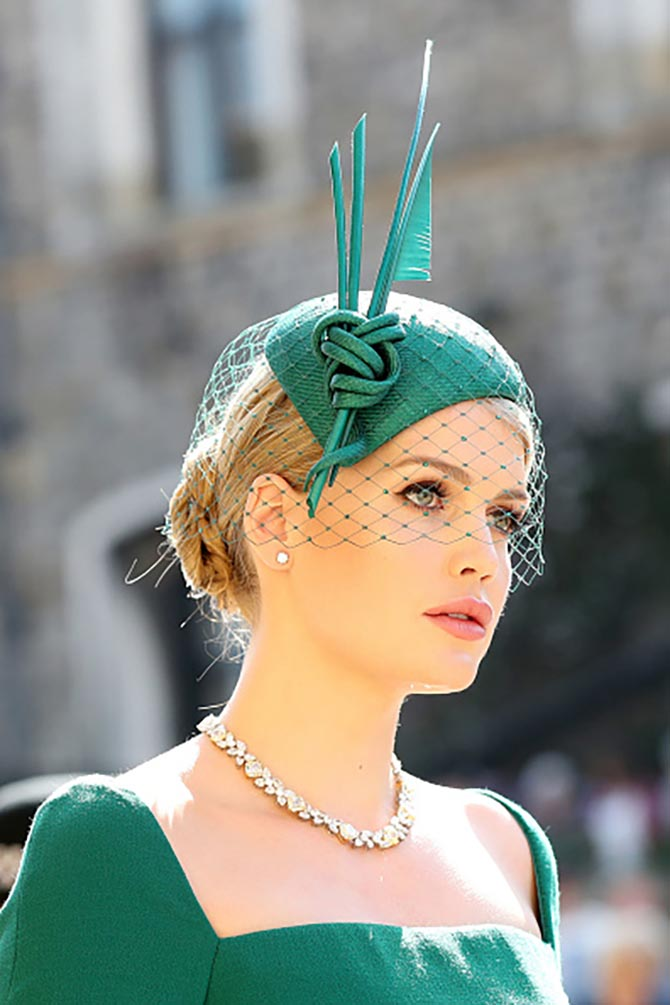 Lady Kitty Spencer paired diamond studs and a necklace with a green hat and dress.