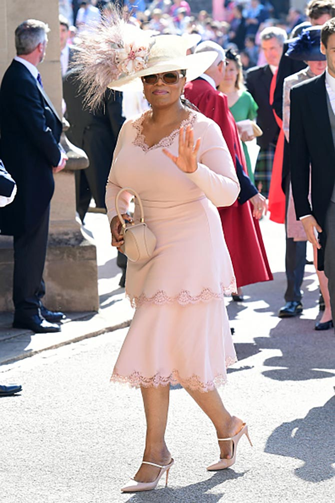 Oprah Winfrey wore stunning diamond pendant earrings she sports routinely with a dress by Stella McCartney and a hat by Philip Treacy.