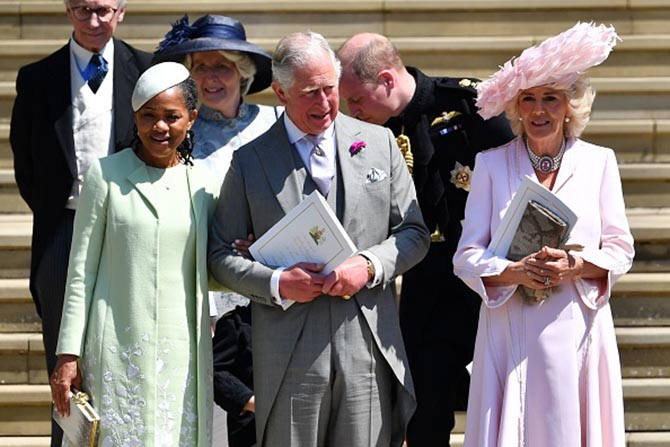 Prince Charles with Doria Ragland who is wearing in an Oscar de la Renta dress, Stephen Jones hat and diamond and pearl earrings and Camilla, Duchess of Cornwall who is wearing an Anna Valentine coat dress, Philip Treacy hat and pink topaz and pearl necklace.