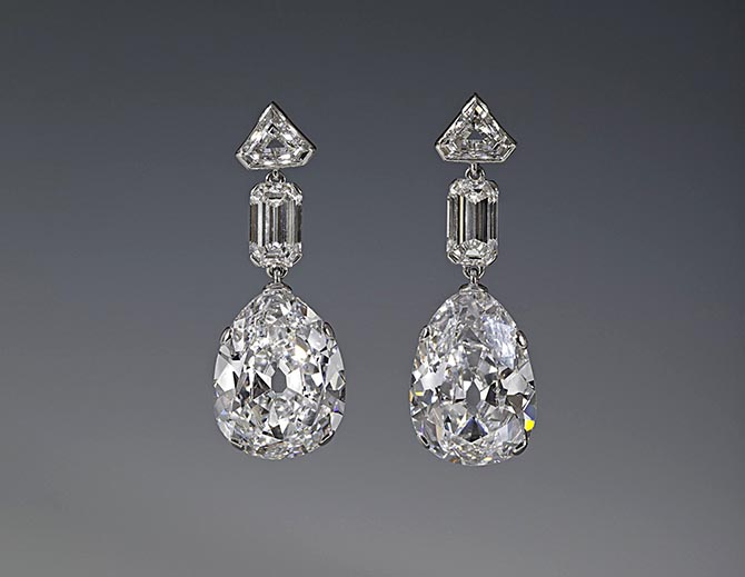 The Greville Peardrop Earrings by Cartier composed of platinum and diamonds including two pear-shapes weighing around 20-carats each. Photo ©The Royal Collection