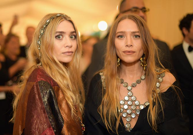 Ashley Olsen and Mary-Kate Olsen in Stephen Russel vintage jewelry.