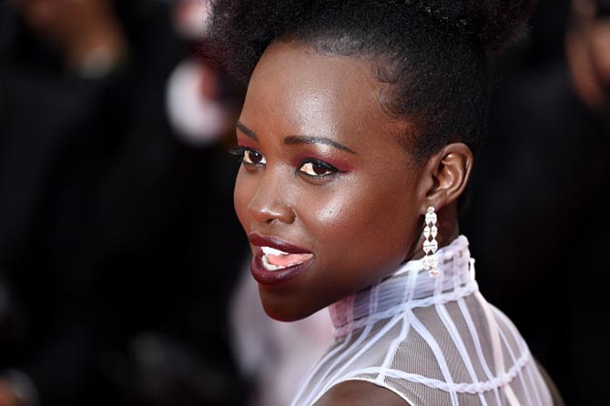 Lupita Nyong'o in diamond earrings by Chopard