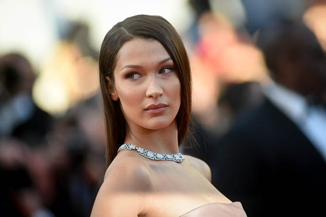 Bella Hadid paired a Bulgari High Jewelry diamond necklace with a Christian Dior strapless gown.