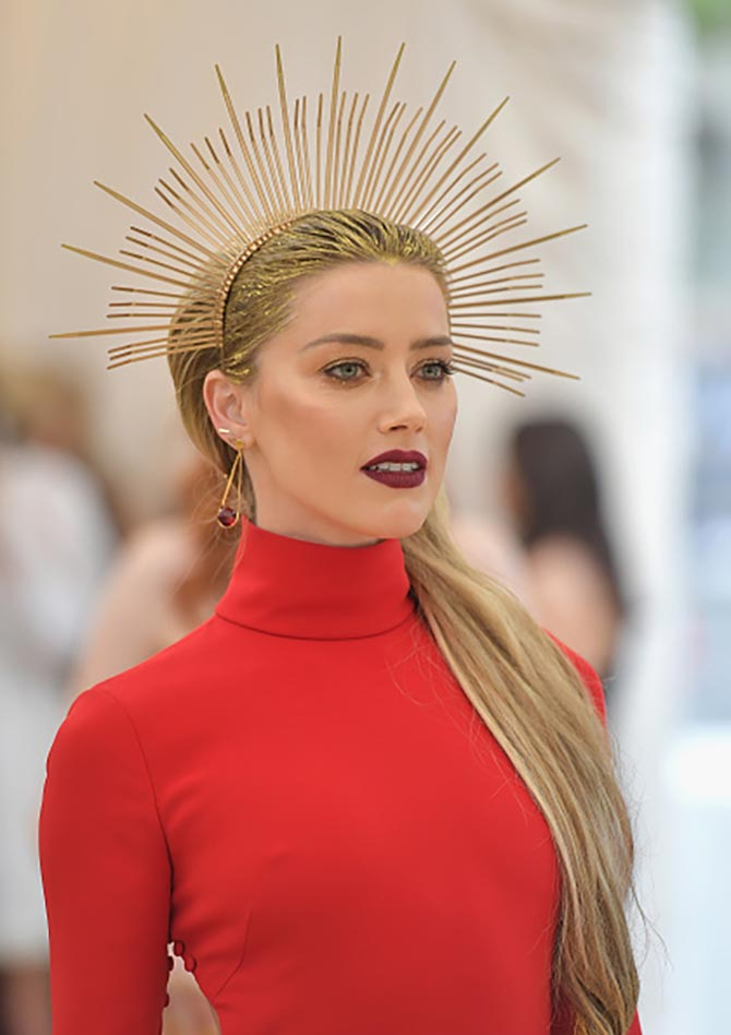 Amber Heard wore a dress by Carolina Herrera and layers of jewels including studs from Jennifer Meyer.